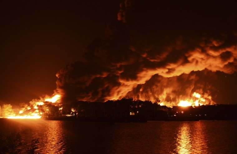 The town burns following a train derailment and explosion in Lac Megantic, Quebec, early July 6, 2013. The train was hauling about 50,000 barrels of crude from North Dakota's Bakken shale development to Irving Oil's 300,000 barrel per day (bpd) plant in Saint John, New Brunswick. (Jean Gauthier/Reuters)