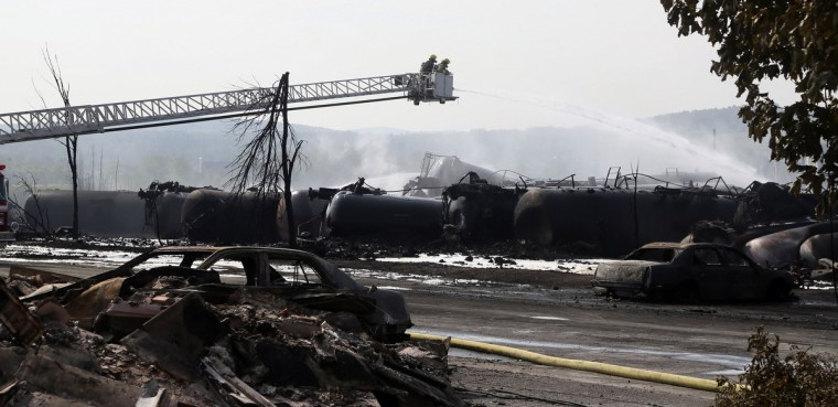 Firefighters work at the scene of a train derailment in Lac Megantic, Quebec, July 7, 2013. (Mathieu Belanger/Reuters)