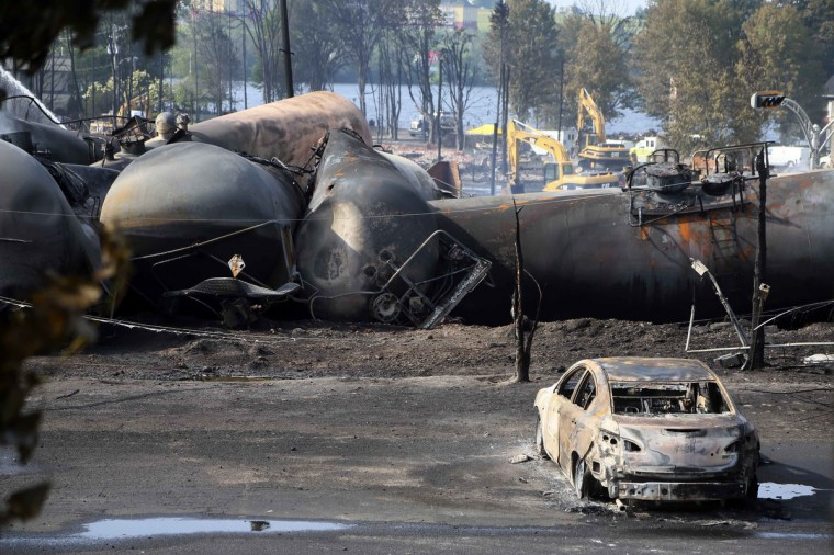 A burnt out vehicle sits near the wreckage of a train car following a train derailment in Lac Megantic, Quebec, July 7, 2013. (Christinne Muschi/Reuters)
