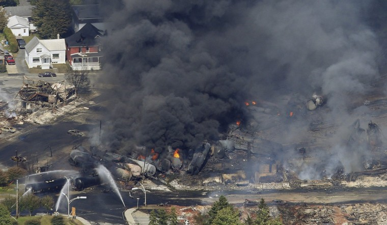 The wreckage of a train is pictured after an explosion in Lac Megantic July 6, 2013. Several people were missing after four tank cars of petroleum products exploded in the middle of a small town in the Canadian province of Quebec early on Saturday in a fiery blast that destroyed dozens of buildings. (Mathieu Belanger/Reuters)