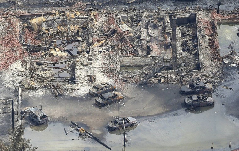 Burnt cars are seen among the remains of downtown Lac Megantic July 8, 2013. (Mathieu Belanger/Reuters)