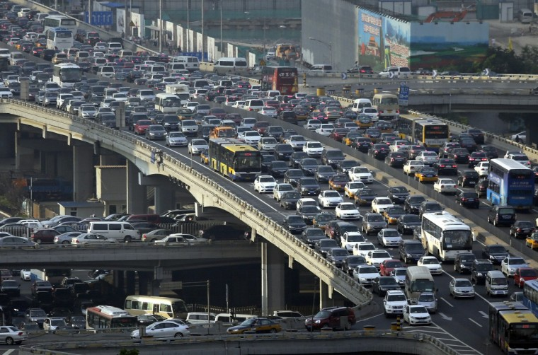 Lines of cars are pictured during a rush hour traffic jam on Guomao Bridge in Beijing. Eight more cities in China, the world's biggest auto market, are likely to announce policies restricting new vehicle purchases, an official at the automakers association said, as Beijing tries to control air pollution. (Jason Lee/Reuters)