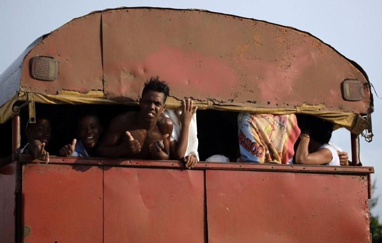 Beachgoers a beach in a truck on the outskirts of Havana July 28, 2013. (Desmond Boylan/Reuters)