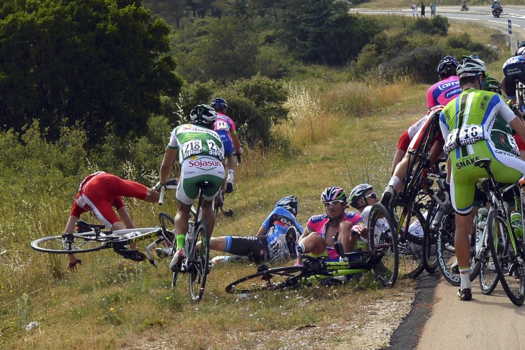 Riders fall during the 228.5 km fifth stage of the centenary Tour de France cycling race from Cagnes-Sur-Mer to Marseille. (Jerome Prevost//Reuters)