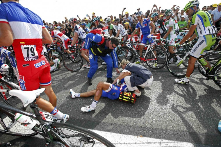 FDJ.FR team rider Nacer Bouhanni of France receives medical treatment after he fell in the last kilometer of the 228.5 km fifth stage of the centenary Tour de France cycling race from Cagnes-Sur-Mer to Marseille. (Eric Gaillard/Reuters)