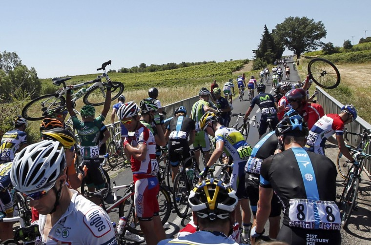 Riders fall during the 205.5 km seventh stage of the centenary Tour de France cycling race from Montpellier to Albi. (Eric Gaillard/Reuters photo)