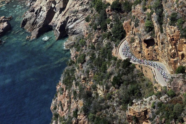 An aerial view shows the pack of riders as they cycle along the coast during the 145,5 km third stage of the centenary Tour de France cycling race from Ajaccio to Calvi, on the French Mediterranean island of Corsica July 1, 2013. (Pascal Pochard-Casabianca/Reuters)