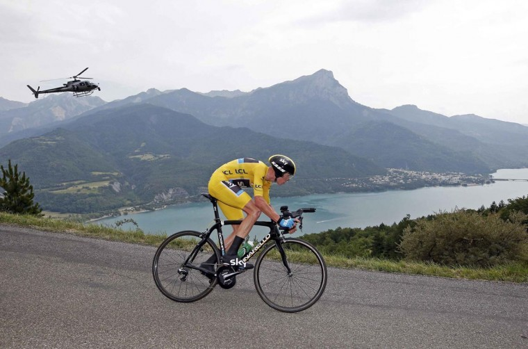 Race leader's yellow jersey holder Team Sky rider Christopher Froome of Britain cycles to win the 32km individual time-trial seventeenth stage of the centenary Tour de France cycling race from Embrun to Chorges July 17, 2013. (Eric Gaillard/Reuters)