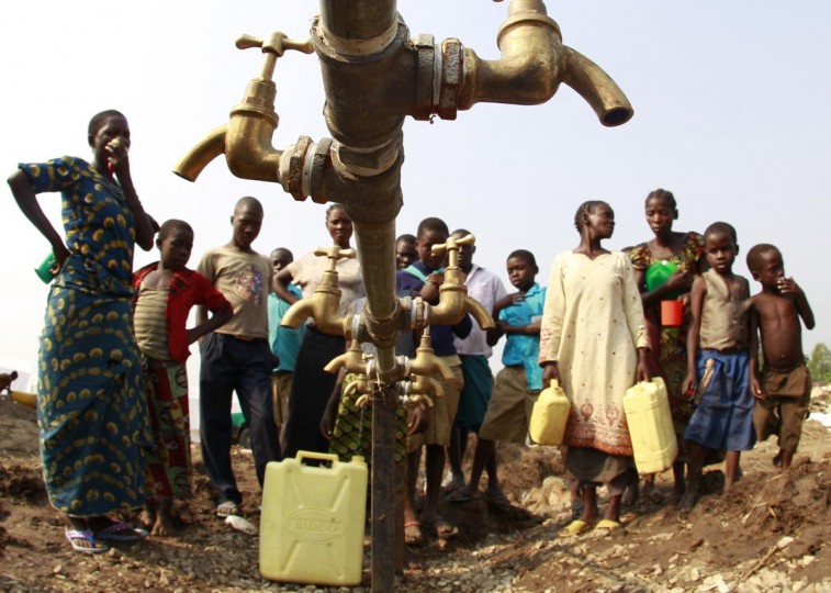 Congolese refugees, displaced by fighting between the Congo army and rebel group Allied Democratic Forces (ADF) last week, gather around dry water taps at Bukanga transit camp in Bundibugyo town camp, 376km (238 miles) southwest of Kampala July 17, 2013. (James Akena/Reuters)