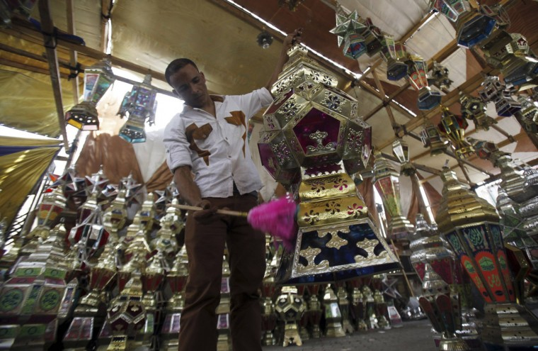 A vendor cleans Ramadan lanterns, or Fanoos Ramadan, which are displayed for sale at a shop a day ahead of the Muslim fasting month of Ramadan, in Cairo July 9, 2013. Ramadan is the ninth and holiest month in the Islamic calendar. (Amr Abdallah Dalsh/Reuters)