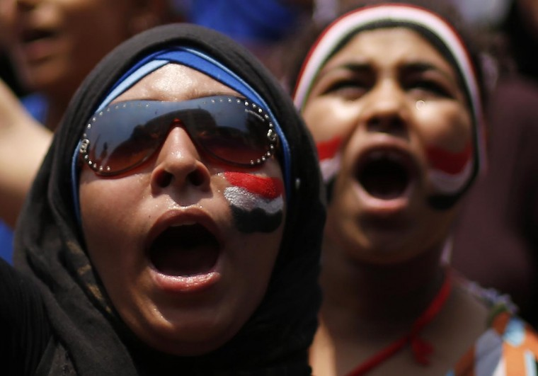Protesters, who are against Egyptian President Mohamed Mursi, shout as they demonstrate inTahrir Square in Cairo July 3, 2013. (Suhaib Salem/Reuters)