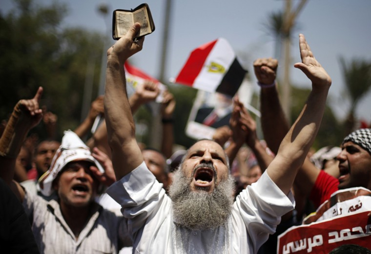 A protester, who supports former Egyptian President Mohamed Mursi, chants slogans during a rally near Cairo University after Friday prayers in Cairo. Islamist allies of ousted president Mursi called on people to protest on Friday to express outrage at his overthrow by the army. (Suhaib Salem/Reuters photo)