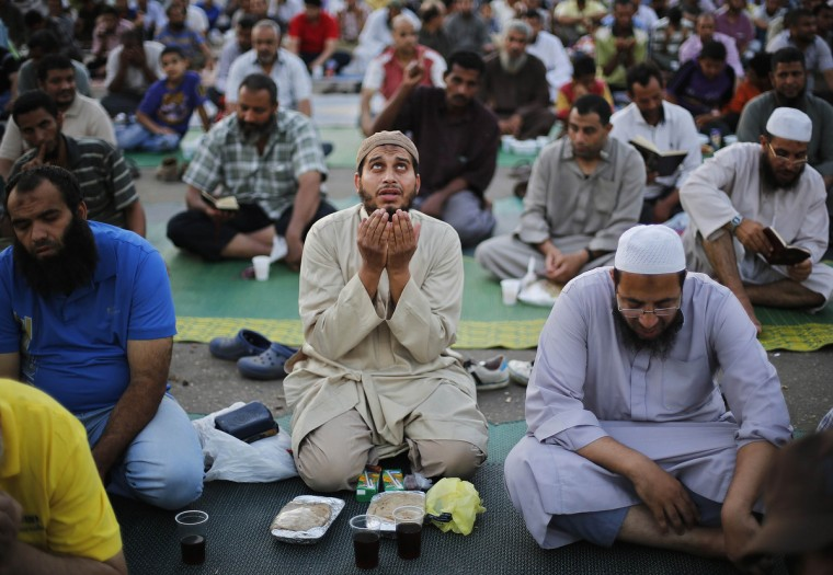 Supporter of the deposed Egyptian President Mohamed Mursi pray before they eat their Iftar meals on the first day of Ramadan, during a sit-in in Cairo July 10, 2013. The White House said on Wednesday it will take time to determine whether the Egyptian military's removal of Mursi constituted a coup, and called on the military to exercise restraint. (Suhaib Salem/Reuters)