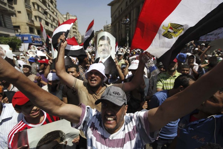 Members of the Muslim Brotherhood and supporters of ousted Egyptian President Mohamed Mursi shout slogans in Cairo July 22, 2013. The family of ousted Egyptian President Mohamed Mursi said on Monday it would take legal action against the army, accusing it of abducting the country's first democratically-elected president. (Mohamed Abd El Ghany/Reuters)