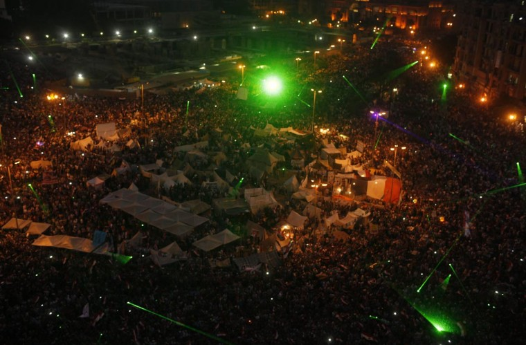 Laser lights are seen as protesters, who are against Egyptian President Mohamed Mursi, gather in Tahrir Square in Cairo July 3, 2013. (Asmaa Waguih/Reuters)