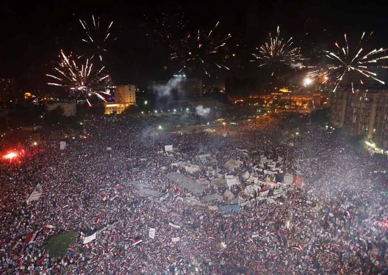 Protesters, who are against Egyptian President Mohamed Mursi, set-off fireworks as they gather in Tahrir Square in Cairo July 3, 2013. (Steve Crisp/Reuters)