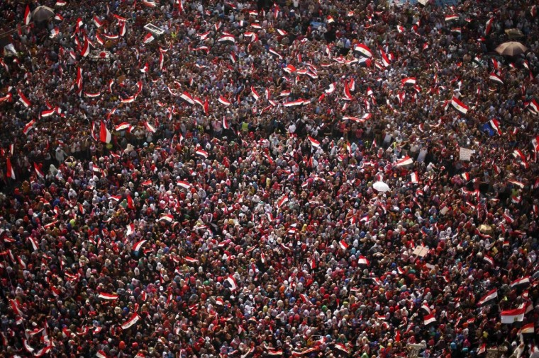 An aerial view shows protesters against Egyptian President Mohamed Mursi waving national flags in Tahrir Square in Cairo July 3, 2013. Egypt's armed forces and Islamist President Mursi refused to back down on Wednesday as a deadline for a military takeover passed with rival demonstrators out in force in the streets of Cairo. (Suhaib Salem/Reuters)