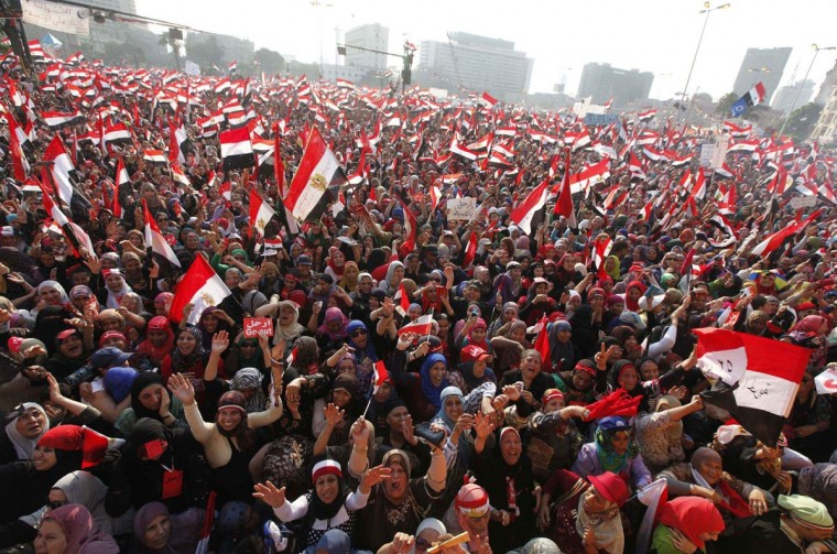 Protesters against Egyptian President Mohamed Mursi wave national flags in Tahrir Square in Cairo July 3, 2013. (Mohamed Abd El Ghany/Reuters)