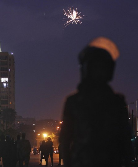 Fireworks are seen as army soldiers take their positions in front of protesters who are against Egyptian President Mohamed Mursi, near the Republican Guard headquarters in Cairo July 3, 2013. The head of Egypt's armed forces General Abdel Fattah al-Sisi issued a declaration on Wednesday suspending the constitution and appointing the head of the constitutional court as interim head of state, effectively declared the removal of elected Islamist President Mohamed Mursi. (Amr Abdallah Dalsh/Reuters)