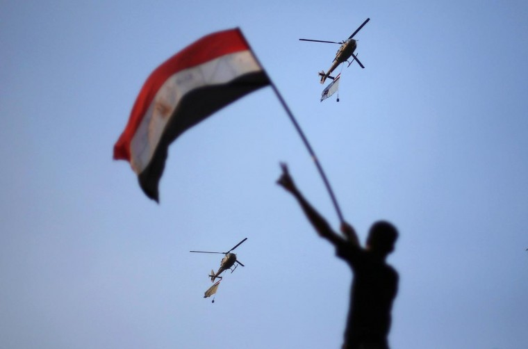 Egyptian military helicopters trailing national flags circled over Tahrir Square during a protest demanding that Egyptian President Mohamed Mursi resign in Cairo July 1, 2013. Five Egyptian military helicopters trailing national flags circled over Cairo on Monday after the armed forces gave politicians 48 hours to resolve a crisis over calls for the resignation of Islamist President Mohamed Mursi. (Suhaib Salem/Reuters)