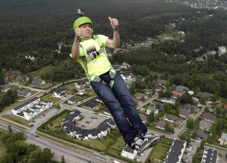 BASE jumper Alexei Shirokoruhov of Russia shows thumbs-up as he leaps before opening his parachute during Tallinn TV Tower B.A.S.E. Boogie 2013 event. More than 60 BASE jumpers from fourteen countries are taking part in this annual event. (Ints Kalnins/Reuters)