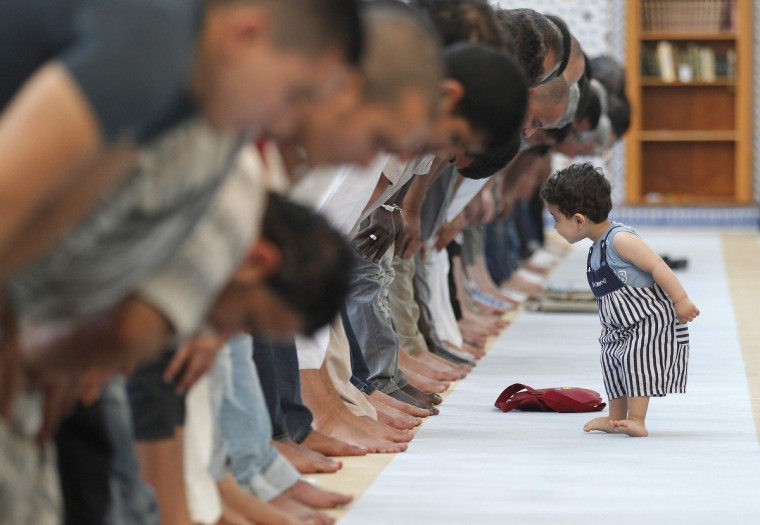A child walks near members of the Muslim community attending midday prayers at Strasbourg Grand Mosque in Strasbourg on the first day of Ramadan. The Grand Mosque of Paris has fixed the first day of Ramadan as Wednesday, splitting with the French Council of Muslim Religion (Conseil Francais du Culte Musulman or CFCM), which determined it would begin on Tuesday. (Vincent Kessler/Reuters)