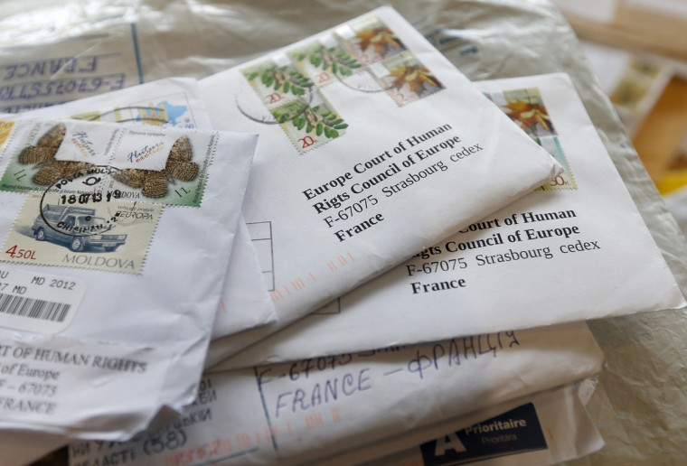 Letters sent to the European Court of Human Rights are seen at the post room of the court in Strasbourg, July 26, 2013. The ECHR post room receives on average 1,400 faxes, emails and letters every day. About 20 percent of these are new requests, which have to be sent by letter in any official language of the Council of Europe's 47 member states. The majority of the post room staff are Russian speakers who can deal with the large volume of requests received from Russia and Ukraine. (Vincent Kessler/Reuters)