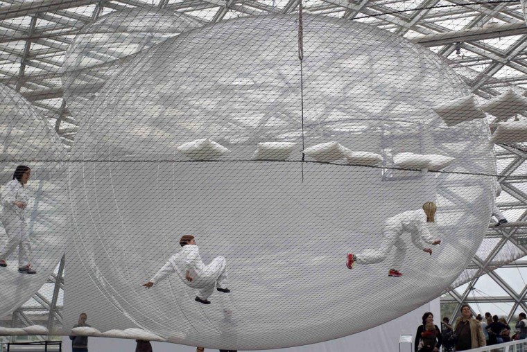 Visitors climb through the art installation 'In Orbit' by Tomas Saraceno of Argentina at the Kunstsammlung K21 museum in Duesseldorf June 30, 2013. (Ina Fassbender/Reuters)