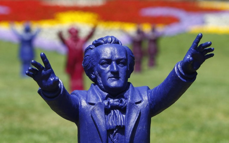 Sculptures of German composer Richard Wagner are seen outside the Gruener Huegel (Green Hill) opera house in Bayreuth July 25, 2013. Some 500 plastic sculptures made by German artist Ottmar Hoerl have been placed around the world famous Wagner opera festival to celebrate the composer's 200th birthday. (Michaela Rehle/Reuters)