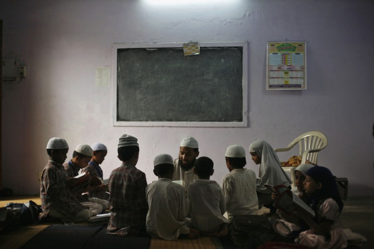 Muslim children learn to read the Koran at a madrassa, or religious school, during the holy month of Ramadan in the old quarters of Delhi. (Mansi Thapliyal/Reuters)