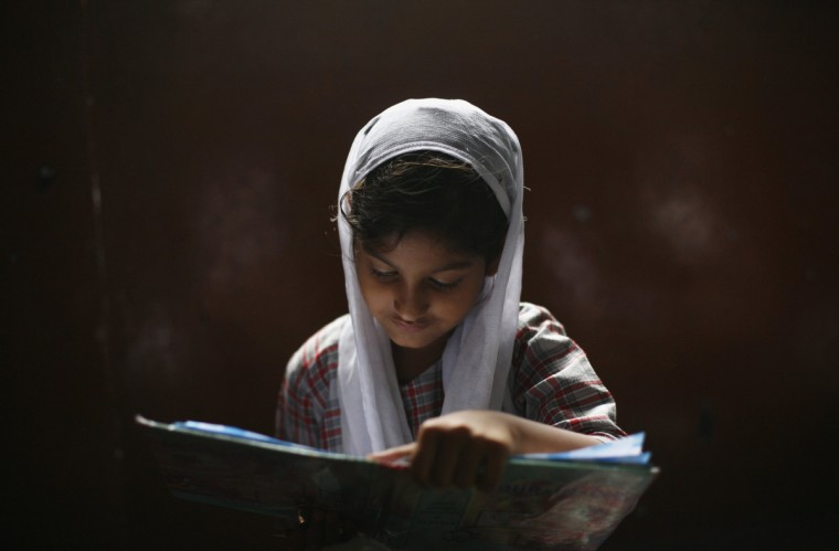 A Muslim girl learns to read the Koran at a madrassa, or religious school, during the holy month of Ramadan in the old quarters of Delhi. (Mansi Thapliyal/Reuters)