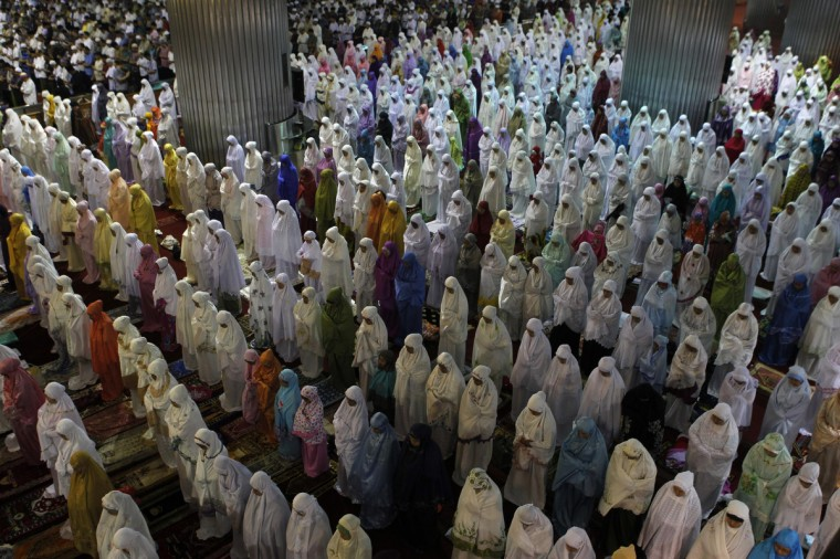 "Muslim women attend an evening mass prayer session called ""tarawih"" to mark the holy fasting month of Ramadan, which will begin on Wednesday, at Istiqlal Mosque in Jakarta July 9, 2013. (Enny Nuraheni/Reuters)"