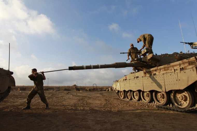 An Israeli soldier cleans the barrel of a tank near the border with Syria in the Israeli-occupied Golan Heights July 17, 2013. Syria's civil war has brought an end to decades of calm on the Golan Heights, a strip of land which Israel captured in the 1967 Middle East war. Battles between rebels fighting against President Bashar al-Assad's forces in Syrian villages nearby are being watched intensely by Israel's military. (Baz Ratner/Reuters)
