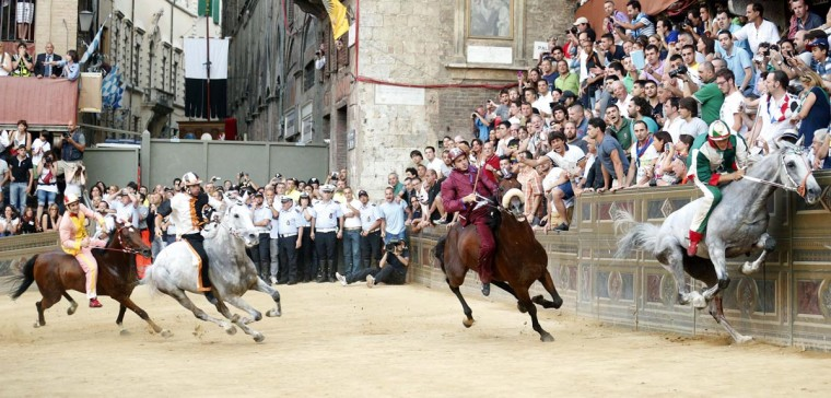Jockey Giovanni Atzeni (R) of the Oca (Goose) parish leads the Palio race in Siena July 2, 2013. Atzeni won the Palio of Siena. (Stefano Rellandini/Reuters)