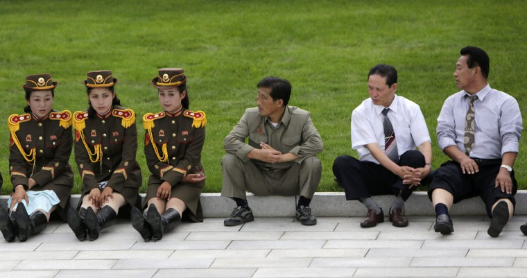North Korean men look at members of a military band as they wait for the opening ceremony of the Victorious Fatherland Liberation War Museum, in Pyongyang July 27, 2013. North Korea is celebrating the 60th anniversary of the signing of a truce in the 1950-1953 Korean War. (Jason Lee/Reuters)