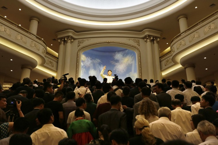 North Koreans and the media arrive to visit after the opening ceremony of the Victorious Fatherland Liberation War Museum, in Pyongyang July 27, 2013, as part of celebrations of the 60th anniversary of the signing of a truce in the Korean War. (Jason Lee/Reuters)