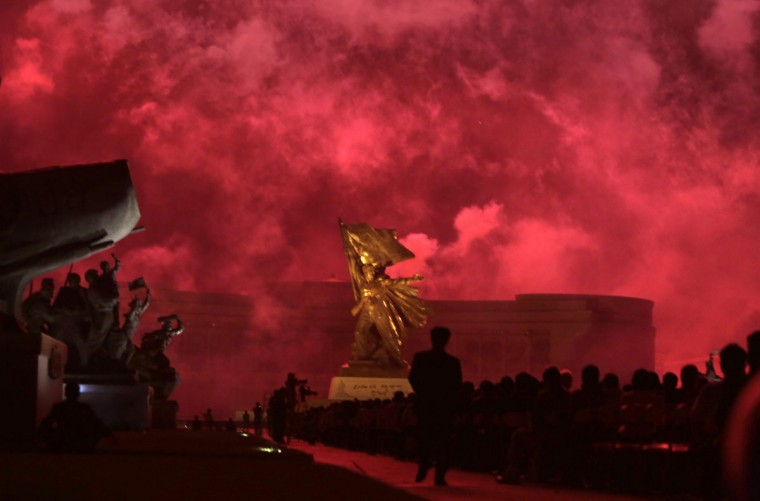 North Koreans watch a fireworks performance during a commemoration event to mark the 60th anniversary of the signing of a truce in the Korean War at the Victorious Fatherland Liberation War Memorial Tower, in Pyongyang July 27, 2013. (Jason Lee/Reuters)