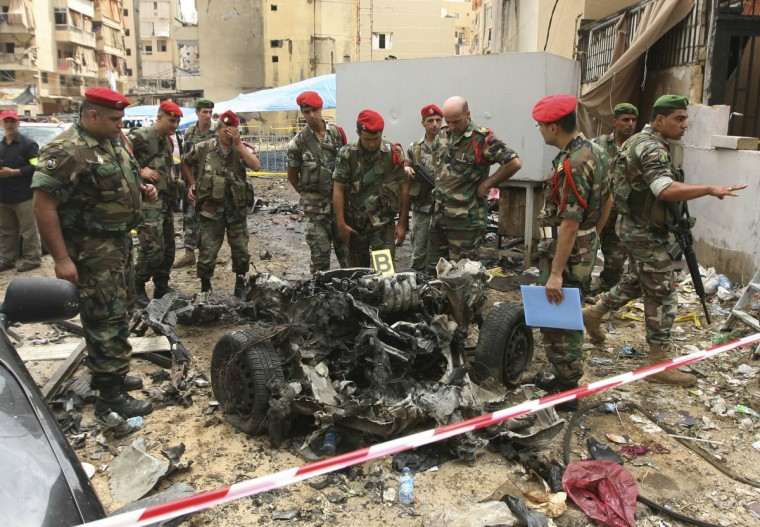 Lebanese military police inspect the remains of a vehicle, at the site of an explosion in Beirut's southern suburbs, July 9, 2013. A car bomb exploded on Tuesday in a Beirut stronghold district of the Lebanese Hezbollah militant group that has been fighting in Syria's civil war, wounding at least 38 people, a hospital official told Reuters. (Hasan Shaaban/Reuters)
