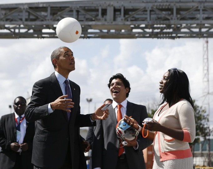 "President Barack Obama heads a soccer ball at Ubungo Power Plant in Dar es Salaam July 2, 2013. The ball called a ""soccket ball"" has internal electronics that allows it to generate and store electricity that can power small devices. (Jason Reed/Reuters)"
