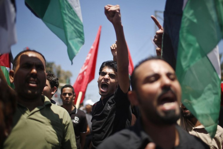 Palestinians chant slogans during a protest against resuming peace talks with Israel, in Gaza City July 28, 2013. Israel was expected on Sunday to approve releasing more than 100 Arab prisoners as a step to renew stalled peace talks with the Palestinians ahead of plans to convene negotiators in Washington later this week. (Mohammed Salem/Reuters)