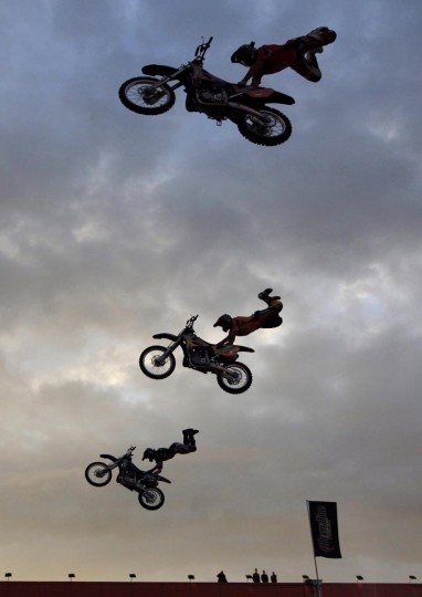 Riders perform during the Adrenaline FMX Rush moto freestyle show in Russia's Siberian city of Krasnoyarsk, July 2, 2013. (Ilya Naymushin/Reuters)