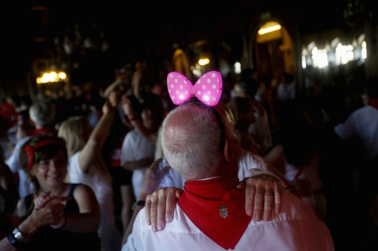 "Two men dance during the ""Baile de la alpargata"" (Espadrille dance) at Pamplona's casino, after the second running of the bulls during San Fermin festival in Pamplona. Visitors to the nine-day festival, depicted in Ernest Hemingway's 1926 novel ""The Sun Also Rises"", take part in activities including the running of the bulls, an early morning half-mile dash from the corral to the bullring alongside six bulls destined to die in the afternoon's corrida. This is followed by processions of giant traditional figures, concerts, firebulls, fireworks, and large doses of eating, drinking, dancing and late nights. (Susana Vera/Reuters photo)"