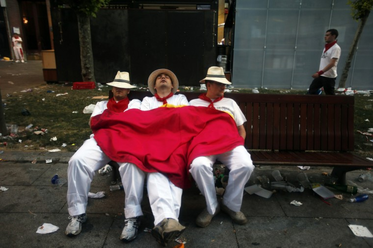 Revellers sleep on the street before the first running of the bulls of the San Fermin festival in Pamplona. (Susana Vera/Reuters photo)