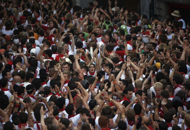 Runners wait for the start of the second running of the bulls of the San Fermin festival in Pamplona. (Susana Vera/Reuters photo)