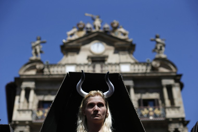 An animal rights protester stands inside a cardboard coffin during a demonstration calling for the abolition of bull runs and bullfights, a day before the start of the famous running of the bulls San Fermin festival, in Pamplona (Susana Vera/Reuters photo)