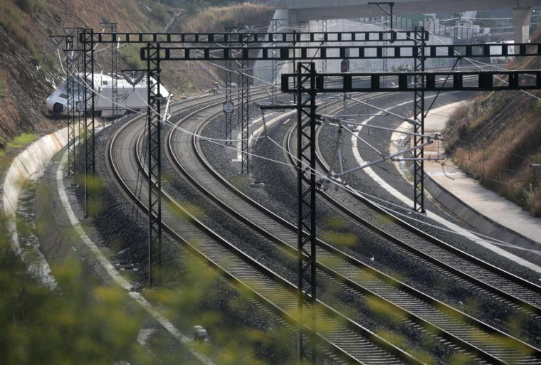 The train engine is seen at the site of a train crash in Santiago de Compostela, northwestern Spain, July 26, 2013. The driver of a Spanish train that derailed, killing at least 80 people, was under police guard in hospital on Friday after the accident, which an official source said was caused by excessive speed. (Miguel Vidal/Reuters photo)