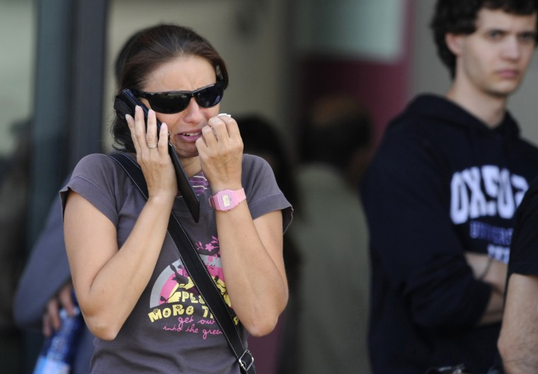 A relative of one of the victims of a train crash cries as she speaks on a phone in Santiago de Compostela, northwestern Spain, July 25, 2013. A train derailed outside the ancient northwestern Spanish city of Santiago de Compostela on Wednesday evening, killing at least 78 people and injuring up to 131 in one of Europe's worst rail disasters. (Eloy Alonso/Reuters photo)