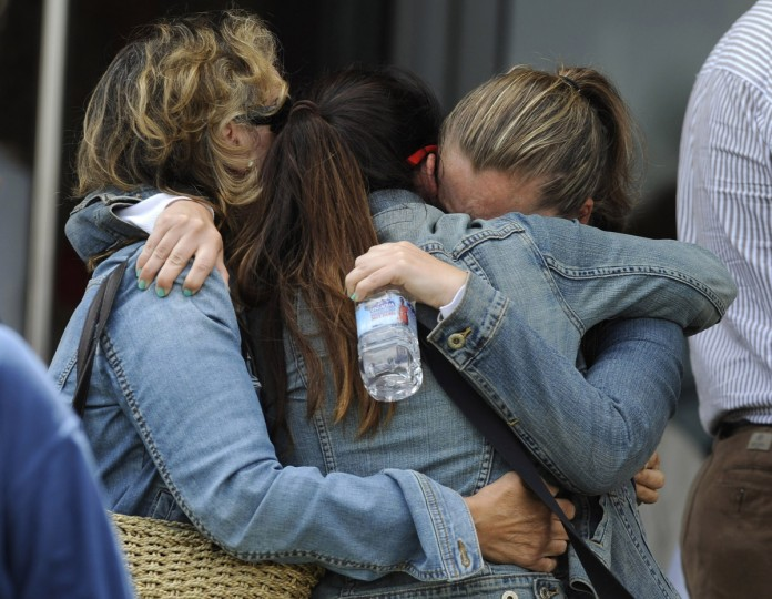 Relatives of one of the victims of a train crash comfort each other in Santiago de Compostela, northwestern Spain, July 25, 2013. A train derailed outside the ancient northwestern Spanish city of Santiago de Compostela on Wednesday evening, killing at least 78 people and injuring up to 131 in one of Europe's worst rail disasters. (Eloy Alonso/Reuters photo)