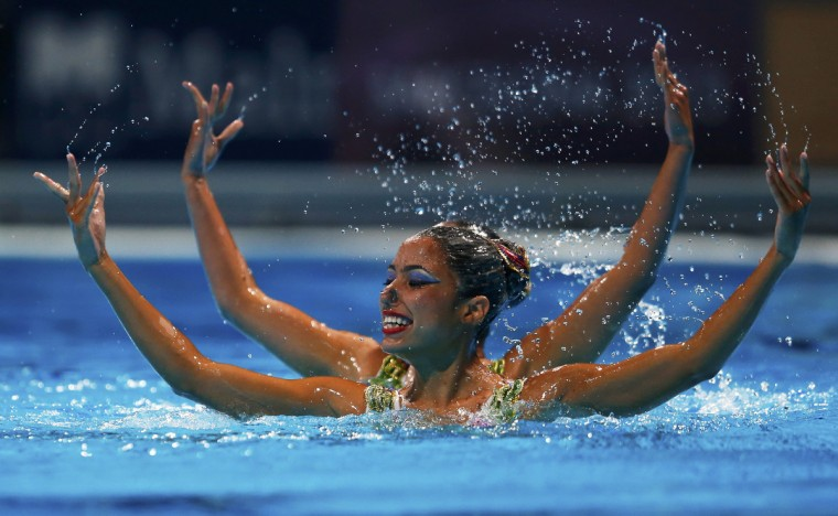 Venezuela's Albany Avila and Karla Loaiza perform in the synchronised swimming duet free preliminaries during the World Swimming Championships at the Sant Jordi arena in Barcelona. (Michael Dalder/Reuters photo)