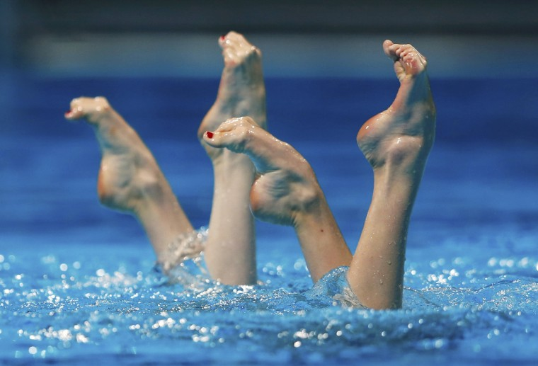 Russia's Svetlana Kolesnichenko and Svetlana Romashina perform in the synchronised swimming duet free preliminaries during the World Swimming Championships at the Sant Jordi arena in Barcelona. (Michael Dalder/Reuters photo)